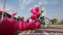 Palestinian women ride bicycles during pink sports entertainment day to raise awareness for early breast cancer screening