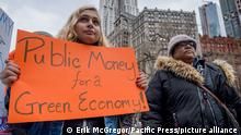 Protesters rally in New York in 2018, calling for the city to establish a municipal public bank to help fund the transition to a just, sustainable economy