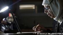 Palestinian grandmother Jihad Butto, 85, uses her laptop, after obtaining a bachelor's degree in religious studies, at her home, in Nazareth, Israel October 8, 2021. Picture taken October 8, 2021. REUTERS/Ammar Awad