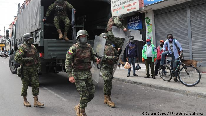 Soldiers in riot gear arrive to reinforce authorities after street merchants protested the seizure of their merchandise by the municipal police of Quito, Ecuador