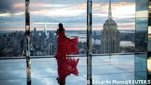 A woman looks at The Empire State Building and the New York Skyline during a preview of SUMMIT One Vanderbilt observation deck, which is spread across the top four floors of the new One Vanderbilt tower in Midtown Manhattan, in New York City, New York, U.S., October 18, 2021. REUTERS/Eduardo Munoz