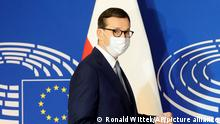 Poland's Prime Minister Mateusz Morawiecki arrives Tuesday, Oct. 19, 2021 at the European Parliament in Strasbourg, eastern France. The European Union's top official locked horns Tuesday with Poland's prime minister, arguing that a recent ruling from the country's constitutional court challenging the supremacy of EU laws is a threat to the bloc's foundations and won't be left unanswered. (Ronald Wittek, Pool Photo via AP)