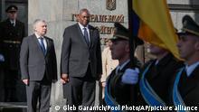 Ukrainian Defense Minister Andriy Taran, left, and U.S. Defense Secretary Lloyd Austin review the honor guard during a welcome ceremony ahead of their meeting in Kyiv, Ukraine, Tuesday, Oct. 19, 2021. (Gleb Garanich/Pool Photo via AP)