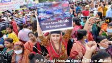 Hundreds of Hindus protesting against attacks on temples and the killing of two Hindu devotees in another district shout slogans in Dhaka, Bangladesh, Monday, Oct.18, 2021. A viral social media image perceived as insulting to the country's Muslim majority last week triggered protests and incidents of vandalism at Hindu temples across Bangladesh. About 9% of Bangladesh's 160 million are Hindus. (AP Photo/Mahmud Hossain Opu)