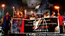 FILE PHOTO: Bangladeshi activists join in a torch procession demanding justice for the violence against Hindu communities during Durga Puja festival in Dhaka, Bangladesh, October 18, 2021. REUTERS/Mohammad Ponir Hossain/File Photo