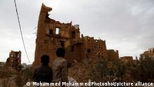 (200326) -- SAADA, March 26, 2020 () -- Children look at houses destroyed by airstrikes during the ongoing war in Saada province, Yemen, March 19, 2020. TO GO WITH Feature: Yemen's war enters 6th year with no end in sight (Photo by Mohammed Mohammed/)