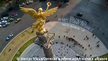 """This photo released by Derecho a Informar shows a bird's eye view of the Angel of Independence monument where a dozen reporters gathered to write, In Mexico they are killing us, and No to silence"""", to call attention to the wave of journalist killings, in Mexico City, Tuesday, May 16, 2017. Javier Valdez, an award-winning reporter who specialized in covering drug trafficking and organized crime, was slain Monday in the northern state of Sinaloa. Valdez is at least the sixth journalist to be murdered in Mexico since early March, an unusually high number even for one of the world's deadliest countries for media professionals. (Hector Vivas via Derecho a Informar via AP)"""