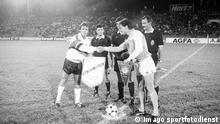 Germany captain Lothar Matthäus (left) shaking hands with his Israeli counterpart before a friendly in 1987
