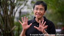 Rappler CEO and Executive Editor Maria Ressa gestures during an interview at a restaurant in Taguig city, Philippines on Saturday, Oct. 9, 2021. The Nobel Peace Prize was awarded to journalists Maria Ressa of the Philippines and Dmitry Muratov of Russia for their fight for freedom of expression. (AP Photo/Aaron Favila)
