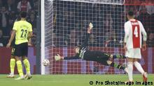Gregor Kobel tries in vain to stop Ajax from scoring