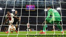 AMSTERDAM, NETHERLANDS - SEPTEMBER 28: Sebastien Haller of Ajax scores their side's second goal past Ersin Destanoglu of Besiktas during the UEFA Champions League group C match between AFC Ajax and Besiktas at Amsterdam Arena on September 28, 2021 in Amsterdam, Netherlands. (Photo by Dean Mouhtaropoulos/Getty Images)