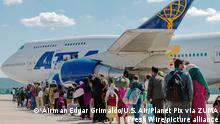 STYLELOCATIONAfghan refugees evacuated from Kabul board an Atlas Air commercial aircraft for a departure flight from Ramstein Air Base September 4, 2021 in Ramstein-Miesenbach, Germany. Ramstein is the primary evacuation hub moving qualified refugees on to more permanent locations. (Credit Image: © Airman Edgar Grimaldo/U.S. Air/Planet Pix via ZUMA Press Wire