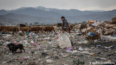 A worker collecting rubbish on the Gonio landfill