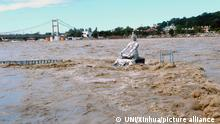 (211019) -- UTTARAKHAND, Oct. 19, 2021 (Xinhua) -- Photo taken on Oct. 19, 2021 shows a statue amid the flooded water of river Ganga in Rishikesh of India's Uttarakhand state. The death toll in India's northern hilly state of Uttarakhand rose to 16 due to raging floods, a state government official said on Tuesday. (UNI via Xinhua)
