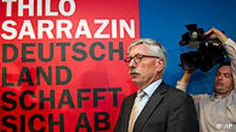 Thilo Sarrazin arrives at a news conference in Berlin.