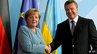 German Chancellor Angela Merkel, left, and Ukrainian President Viktor Yanukovych