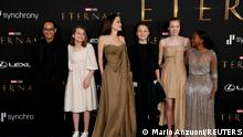 Cast member Angelina Jolie poses with her children Maddox, Vivienne, Zahara, Shiloh and Knox at the premiere for the film Eternals in Los Angeles, California, U.S., October 18, 2021. Picture taken October 18, 2021. REUTERS/Mario Anzuoni TPX IMAGES OF THE DAY