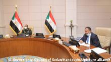 KHARTOUM, SUDAN - APRIL 16: (---EDITORIAL USE - ONLY MANDATORY CREDIT - Sovereignty Council of Sudan / HANDOUT - NO MARKETING NO ADVERTISING CAMPAIGNS - DISTRIBUTED AS A SERVICE TO CLIENTS----) Sudanese Prime Minister Abdullah Hamduk and the Chairman of the Sovereignty Council Gen. Abdel Fattah Abdelrahman al-Burhan (L) attend a meeting of the Defence and National Security Council, in Khartoum, Sudan on April 16, 2021. Sovereignty Council of Sudan/Handout / Anadolu Agency