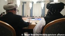 MOSCOW, RUSSIA - OCTOBER 20, 2021: Taliban (banned in Russia) officials Shahabuddin Delavar (L) and Abdul Salam Hanafi attend the 3rd meeting of the Moscow Format on the Afghanistan peace settlement at President Hotel. Sergei Bobylev/TASS