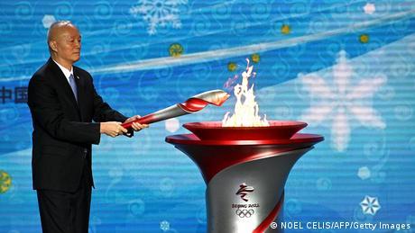 Cai Qi lights the Olympic cauldron
