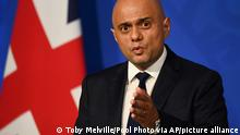 Britain's Health Secretary Sajid Javid speaks during a media briefing in Downing Street, London, Wednesday, Oct. 20, 2021. The U.K. recorded almost 50,000 new infections in a single day this week, and cases have risen 16% from a week earlier. Matthew Taylor, chief executive of health care umbrella group the NHS Confederation, said the health system risks being overwhelmed unless measures are introduced now. (Toby Melville/Pool Photo via AP)