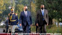 (211020) -- BUCHAREST, Oct. 20, 2021 (Xinhua) -- U.S. Secretary of Defense Lloyd Austin (R) attends an official welcoming ceremony with Romania's Defense Minister Nicolae Ciuca in Bucharest, Romania, Oct. 20, 2021. Austin pledged here on Wednesday to continue to work with partners in the Black Sea region. (Photo by Cristian Cristel/Xinhua)