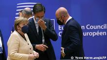 (From L) German Chancellor Angela Merkel, Dutch Prime Minister Mark Rutte and European Council President Charles Michel take part in the first day of a European Union (EU) summit at The European Council Building in Brussels on October, 21 2021 as EU leaders discuss Covid-19, digital transformation, energy prices, migration, trade and external relations. (Photo by YVES HERMAN / POOL / AFP)