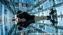 Visitors lie down in a mirrored room as the Empire State Building looms above midtown during the grand opening of SUMMIT One Vanderbilt, a skyscraper observatory on Manhattan's iconic 42nd Street, Thursday, Oct. 21, 2021, in New York. (AP Photo/John Minchillo)