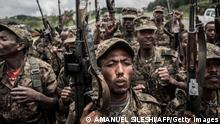 TOPSHOT - Ethiopian National Defence Forces (ENDF) soldiers shout slogans after finishing their training in the field of Dabat, 70 kilometres northeast of the city of Gondar, Ethiopia, on September 14, 2021. (Photo by Amanuel Sileshi / AFP) (Photo by AMANUEL SILESHI/AFP via Getty Images)