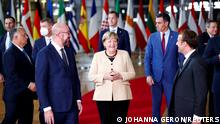 FILE PHOTO: European Council President Charles Michel, German Chancellor Angela Merkel, French President Emmanuel Macron and members of the European Council pose for a family photo during a face-to-face EU summit in Brussels, Belgium, October 21, 2021. REUTERS/Johanna Geron/File Photo