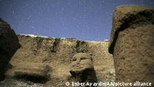 SANLIURFA, TURKEY - SEPTEMBER 30: Human depictions and obelisks are seen at Karahantepe, one of the important settlements of the Neolithic period, during the night hours in Haliliye district of Sanliurfa, Turkey on September 30, 2021. Esber Ayaydin / Anadolu Agency