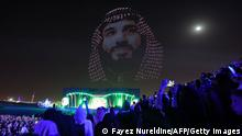 An image of Saudi crown prince Mohammed bin Salman is displayed on the opening night of the Riyadh Season festivities in the Saudi capital late on October 20, 2021. - The arts and culture festival began yesterday and runs until March 2022 in Riyadh. (Photo by Fayez Nureldine / AFP) (Photo by FAYEZ NURELDINE/AFP via Getty Images)