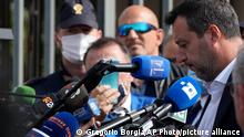 Former minister of interior Matteo Salvini talks to journalists outside Palermo's court, Italy, Saturday, Oct. 23, 2021. Italy's former right-wing interior minister, Matteo Salvini, went on trial Saturday charged with kidnapping for refusing 2019 to allow a Spanish migrant rescue ship to dock in Sicily, keeping the people onboard at sea for days. (AP Photo/Gregorio Borgia)