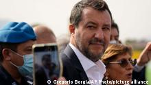 Former minister of interior Matteo Salvini and his lawyer Giulia Bongiorno talk to journalists outside Palermo's court, Italy, Saturday, Oct. 23, 2021. Italy's former right-wing interior minister, Matteo Salvini, went on trial Saturday charged with kidnapping for refusing 2019 to allow a Spanish migrant rescue ship to dock in Sicily, keeping the people onboard at sea for days. (AP Photo/Gregorio Borgia)