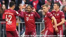 Bayern's Serge Gnabry, second left, celebrates after scoring his side's opening goal during the German Bundesliga soccer match between Bayern Munich and TSG 1899 Hoffenheim at the Allianz Arena stadium in Munich, Germany, Saturday, Oct. 23, 2021. (AP Photo/Matthias Schrader)
