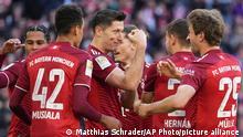 Bayern's Robert Lewandowski, centre, celebrates after scoring his side's second goal during the German Bundesliga soccer match between Bayern Munich and TSG 1899 Hoffenheim at the Allianz Arena stadium in Munich, Germany, Saturday, Oct. 23, 2021. (AP Photo/Matthias Schrader)
