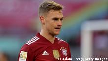 MUNICH, GERMANY - OCTOBER 23: Joshua Kimmich of FC Bayern Muenchen looks on during the Bundesliga match between FC Bayern München and TSG Hoffenheim at Allianz Arena on October 23, 2021 in Munich, Germany. (Photo by Adam Pretty/Getty Images)