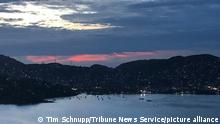 Dusk settles over Zihuatanejo, Mexico, on July 17, 2019. (Tim Schnupp/Tribune News Service/TNS) Photo via Newscom picture alliance