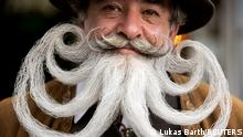Participant Norbert Dopf from Austria arrives for the German Moustache and Beard Championships 2021 at Pullman City Western Theme Park in Eging am See, Germany, October 23, 2021. REUTERS/Lukas Barth TPX IMAGES OF THE DAY