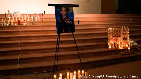 Candles are lit around a photo of cinematographer Halyna Hutchins during a candlelight vigil in Albuquerque