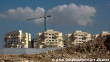 FILE - In this Jan. 1, 2019 file photo, a new housing project is seen in the West Bank settlement of Modiin Ilit. A West Bank settler group said in a report issued Tuesday, Feb. 5, 2019, that the number of people living in Israeli Jewish settlements surged at a much faster rate than the overall Israeli population last year. Baruch Gordon, director of West Bank Jewish Population Stats, is predicting an even faster growth rate in the coming years, thanks to what he says is a friendly environment under the Trump administration. (AP Photo/Ariel Schalit, File)