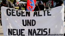 FILE PHOTO: Protesters hold a banner reading Against Old And New Nazis! during a vigil against the ultra-right so-called Der Dritte Weg, in Guben, Germany, October 23, 2021. REUTERS/Michele Tantussi/File Photo