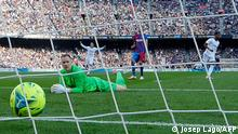Barcelona's German goalkeeper Marc-Andre ter Stegen looks at the ball after conceding the opening goal during the Spanish League football match between FC Barcelona and Real Madrid CF at the Camp Nou stadium in Barcelona on October 24, 2021. (Photo by Josep LAGO / AFP)