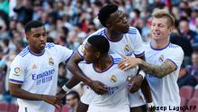 Real Madrid's Austrian defender David Alaba (2L) celebrates scoring the opening goal during the Spanish League football match between FC Barcelona and Real Madrid CF at the Camp Nou stadium in Barcelona on October 24, 2021. (Photo by Josep LAGO / AFP)