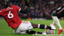 MANCHESTER, ENGLAND - OCTOBER 24: Naby Keita of Liverpool is fouled by Paul Pogba of Manchester United leading to a red card being shown following a VAR review during the Premier League match between Manchester United and Liverpool at Old Trafford on October 24, 2021 in Manchester, England. (Photo by Michael Regan/Getty Images)