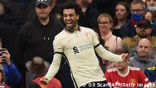 Liverpool's Egyptian midfielder Mohamed Salah celebrates after scoring their third goal during the English Premier League football match between Manchester United and Liverpool at Old Trafford in Manchester, north west England, on October 24, 2021. - RESTRICTED TO EDITORIAL USE. No use with unauthorized audio, video, data, fixture lists, club/league logos or 'live' services. Online in-match use limited to 120 images. An additional 40 images may be used in extra time. No video emulation. Social media in-match use limited to 120 images. An additional 40 images may be used in extra time. No use in betting publications, games or single club/league/player publications. (Photo by Oli SCARFF / AFP) / RESTRICTED TO EDITORIAL USE. No use with unauthorized audio, video, data, fixture lists, club/league logos or 'live' services. Online in-match use limited to 120 images. An additional 40 images may be used in extra time. No video emulation. Social media in-match use limited to 120 images. An additional 40 images may be used in extra time. No use in betting publications, games or single club/league/player publications. / RESTRICTED TO EDITORIAL USE. No use with unauthorized audio, video, data, fixture lists, club/league logos or 'live' services. Online in-match use limited to 120 images. An additional 40 images may be used in extra time. No video emulation. Social media in-match use limited to 120 images. An additional 40 images may be used in extra time. No use in betting publications, games or single club/league/player publications. (Photo by OLI SCARFF/AFP via Getty Images)