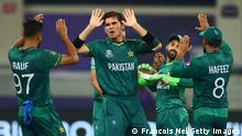 DUBAI, UNITED ARAB EMIRATES - OCTOBER 24: Shaheen Afridi of Pakistan celebrates the wicket of Virat Kohli of India during the ICC Men's T20 World Cup match between India and Pakistan at Dubai International Stadium on October 24, 2021 in Dubai, United Arab Emirates. (Photo by Francois Nel/Getty Images)
