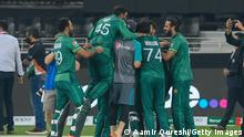 Pakistan's team members celebrate their victory at the end of the ICC mens Twenty20 World Cup cricket match between India and Pakistan at the Dubai International Cricket Stadium in Dubai on October 24, 2021. (Photo by Aamir QURESHI / AFP) (Photo by AAMIR QURESHI/AFP via Getty Images)