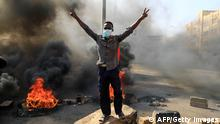 TOPSHOT - Sudanese protesters burn tyres to block a road in 60th Street in the capital Khartoum, to denounce overnight detentions by the army of members of Sudan's government, on October 25, 2021. - Armed forces detained Sudan's Prime Minister over his refusal to support their coup, the information ministry said, after weeks of tensions between military and civilian figures who shared power since the ouster of autocrat Omar al-Bashir. (Photo by AFP) (Photo by -/AFP via Getty Images)