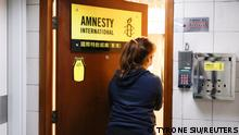 A woman enters the Amnesty International Hong Kong office, after its announcement to close citing China-imposed national security law, in Hong Kong, China October 25, 2021. REUTERS/Tyrone Siu